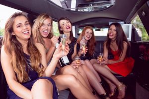 happy friends traveling with style and comfort in a limousine